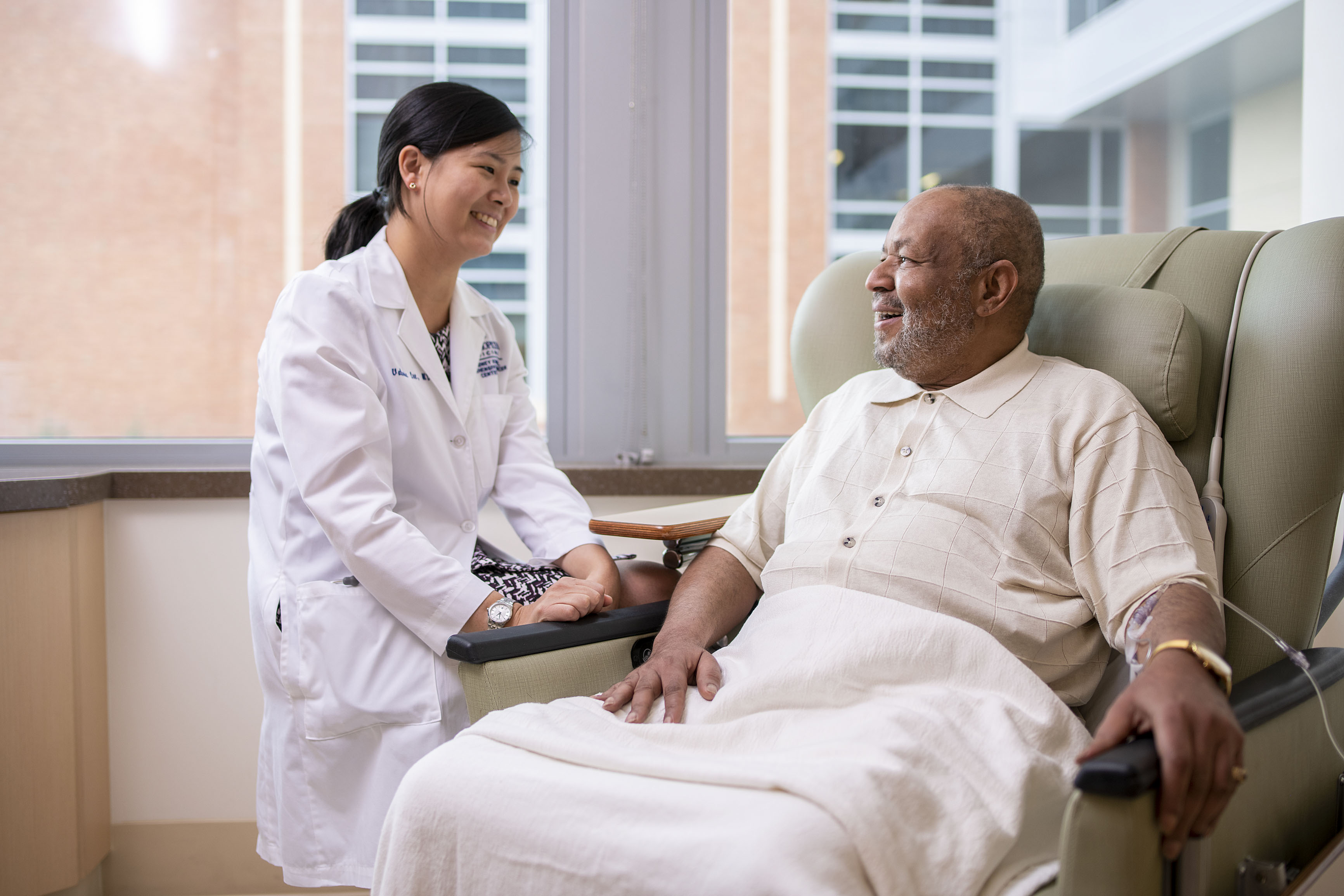 female doctor with older male patient